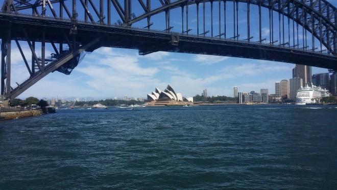 Opera House under the Harbor Bridge in Sydney