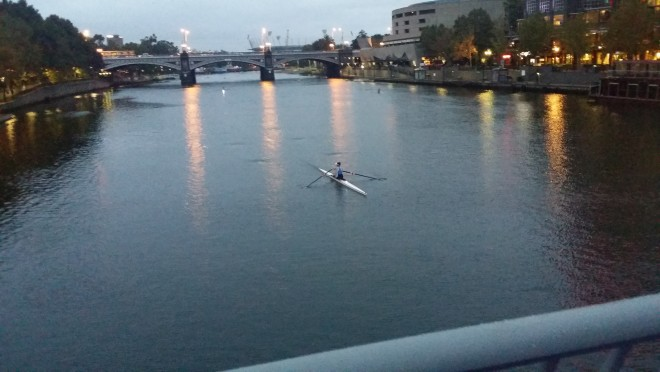 Early morning sculler on Yarra River in Melbourne