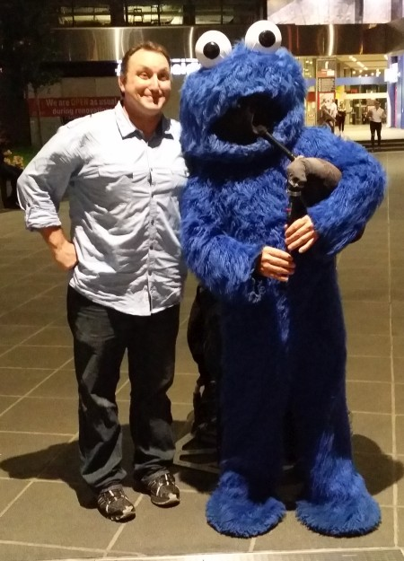 Zack with bagpipes-playing Cookie Monster in Melbourne