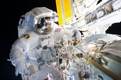 Astronaut working outside the space station